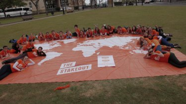 About 50 young Australians gathered in Queens Park on Sunday to highlight recent cuts to foreign aid.