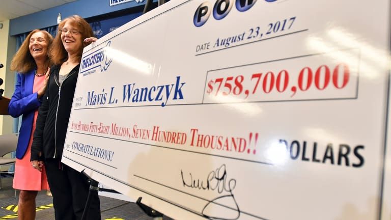 Wanczyk stands by a poster of her winnings.