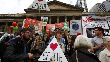 Demonstrators gather at the State Library to demand strong action on climate change.