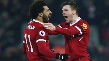 Liverpool's Andrew Robertson (right) celebrates with Mohamed Salah after Salah scored his side's fourth goal.