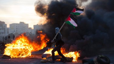 A Palestinian protester clashes with Israeli troops during protests against US President Donald Trump's decision to recognise Jerusalem as the capital of Israel.