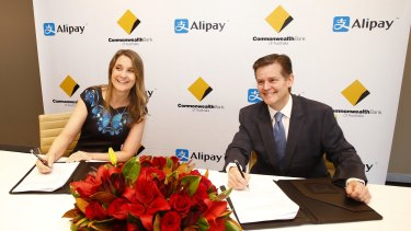 Kelly Bayer Rosmarin, group executive for institutional banking and markets at CBA, and Douglas Feagin, senior vice-president at Ant Financial Services, operator of Alipay, in Sydney last week.