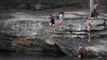 Kids cool off at Parramatta Lake, as temperatures in the city's west climbed to almost 40 degrees.