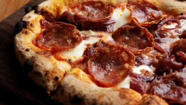 A pizza piccante with 'nduja, salami, fior di latte and caramelised onions.