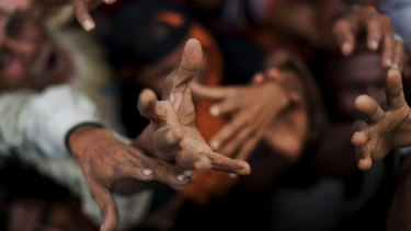 Rohingya reach out for rations in Kutupalong, Bangladesh.