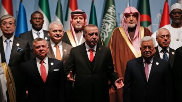 Turkish President Recep Tayyip Erdogan, centre, flanked by Jordanian King Abdullah II, left, and Palestinian President Mahmoud Abbas, right, prior to the opening session of the Organisation of Islamic Cooperation Extraordinary Summit in Istanbul, on Wednesday.