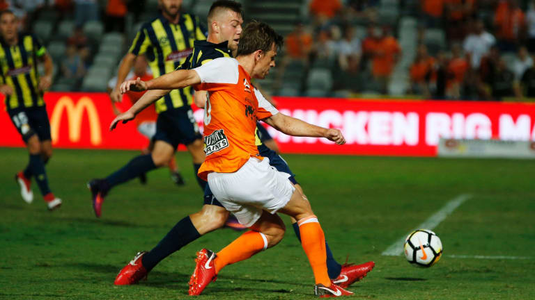 Target practice: Brett Holman takes a shot against the Mariners at Central Coast Stadium.