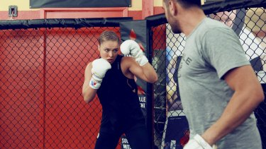 """""""I punched him in the face with a straight right, then a left hook,"""" she writes. """"He staggered back and fell against the door"""": Rousey in her autobiography."""