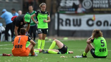 Dejected Canberra United players after their heavy defeat to Sydney FC.