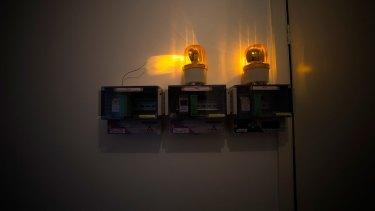 Flashing lights illuminate the interior of the Boronia house.