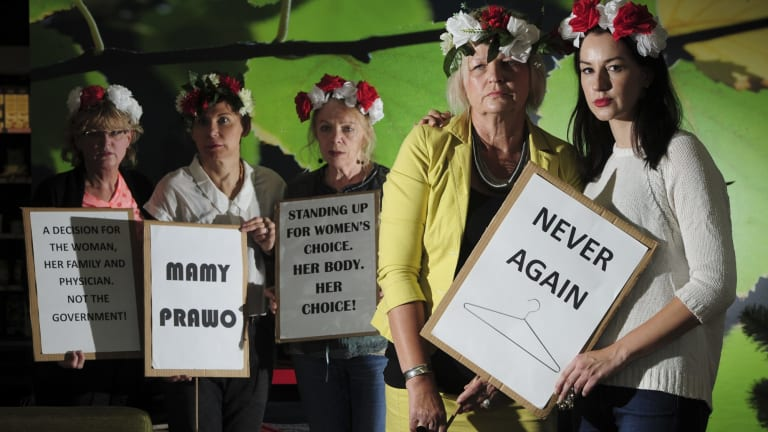 Canberra Polish women are against a new bill to ban abortion in Poland. Mother and daughter, Dana, left and Patricia Olejniczak at right foreground, with other Polish supporters from left, Mira Kwasik, Beata Wilder and Danuta Soczynski.
