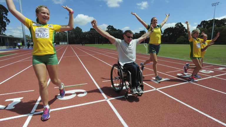The $7m refurbishment of the Woden athletics track. Commonwealth Games medalist in the Javelin, Kelsey-Lee Roberts, centre, is joined by Woden Little Athletics club members from left Rori Pryor, 11, Adela Russell, 11 and Siena Russell, 10. and paralympian, Richard Nicholson, at the track.