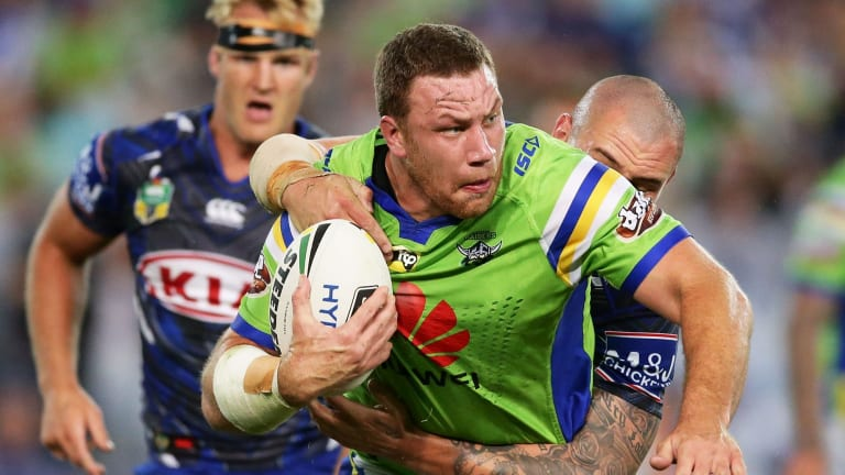 Tight battle: Shannon Boyd is wrapped up by David Klemmer.