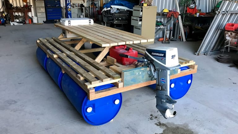 The floating picnic table with an outboard set to make waves in perth watchthetrailerfo