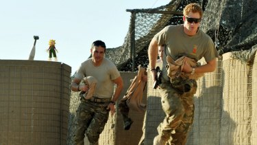 Prince Harry runs to scramble his Apache with fellow pilots in Camp Bastion, Afghanistan, on November 3, 2012.