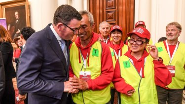 Premier Daniel Andrews with one of the walk organisers, Charles Zhang, after the apology.