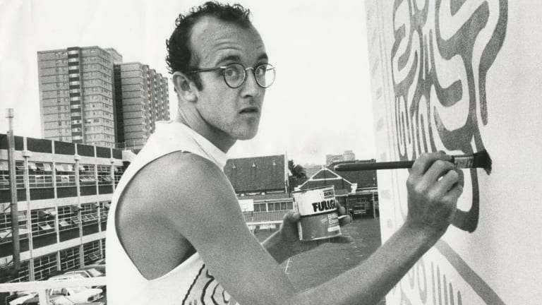 New York graffiti artist Keith Haring at work on the Collingwood Technical School wall in Johnston Street in March 1984.