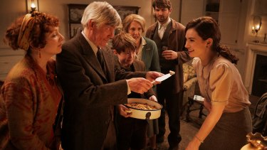 Lily James (right) as Juliet in a scene from the film The Guernsey Literary & Potato Peel Pie Society.