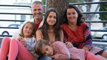Stu White and Jodie McGregor with their three children, Pirra, 12, Remi, 10, and Carter, 8, in Annandale.