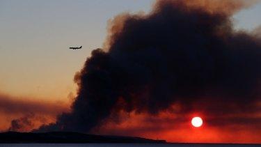 Smoke from a bushfire near Kurnell earlier this week, not far from Sydney Airport.