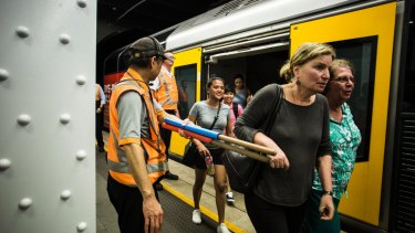 Relieved commuters emerge onto the platform at Wynyard Station.