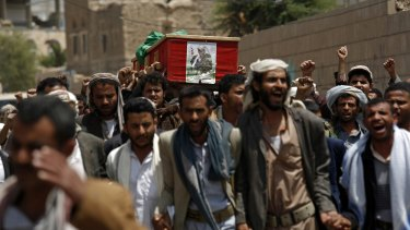 Shiite rebels, known as Houthis, carry the coffin of a fellow Houthi who was killed during fighting against  Saudi-backed Yemeni forces in Marib province.