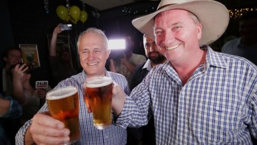 Prime Minister Malcolm Turnbull and Barnaby Joyce celebrate on Saturday.