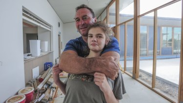 """Canberra Raiders coach Ricky Stuart, pictured with his 18-year-old autistic daughter Emma at his respite house, wants Pauline Hanson to give disabled children a """"fair go""""."""