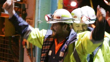 Miners Todd Russell, left, and Brant Webb, smile as the arrive above ground after spending two weeks trapped underground.