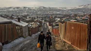Residents walk through one of the so-called ger districts in Ulaanbaatar. According to government figures, around 80 per cent of the capital's air pollution is produced by people living in the districts.