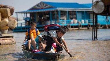 Children paddle to school.