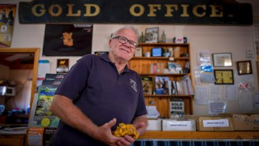 John Gladdis with a gold nugget replica at his shop in Maryborough.