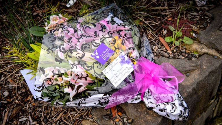 Flowers at the scene of the fatal crash at Surrey Hills train station.