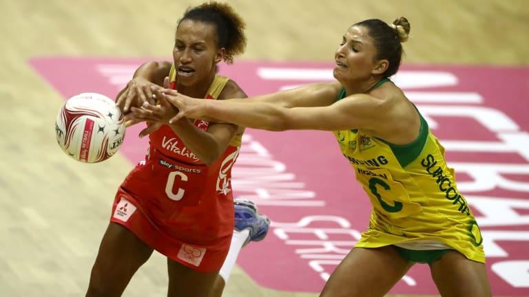 Australia's Kim Ravaillion battles England's Serena Guthrie.