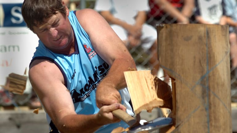 A competitor in the woodchopping competition at the Royal Canberra Show in 2016.