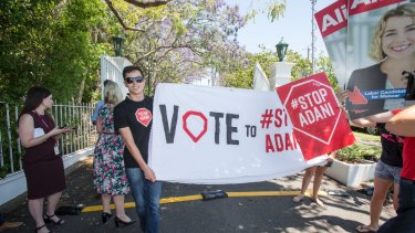 Anti-Adani protesters gathered outside the gates of Government House.