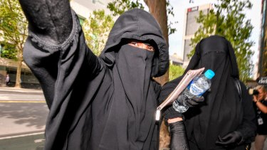 Two women believed to be friends or family of the accused terrorists leave Melbourne Magistrates Court.