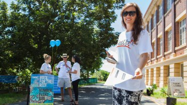 A volunteer from GetUp hands out how-to-vote cards during the Queensland election in 2015.