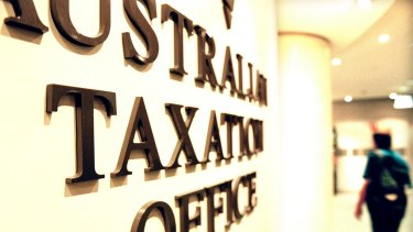 The Tax Office is fighting with the Australian Services Union over a trial of hot-desking at two offices.