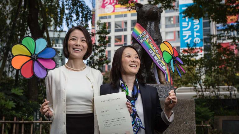 Japanese couple Koyuki Higashi, left, and Hiroko Masuhara hold up their certificate in Tokyo's Shibuya ward on Thursday, November 5.
