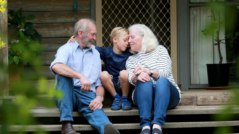Christine and John Snelling with their grandson, six-year-old Cassius.