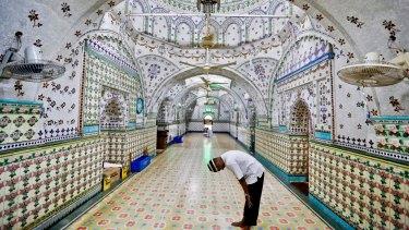 A Bangladeshi Muslim man prays at a Mosque  in Dhaka, Bangladesh.