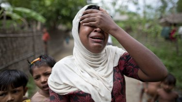 Salema Khatu reacts after seeing a photograph of her son, Habil, who died in an area for Muslim refugees in north of Sittwe, Myanmar.