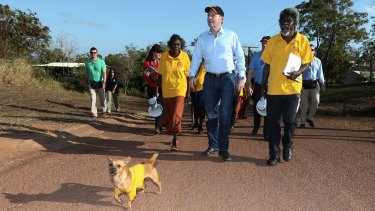 Prime Minister Tony Abbott joins school attendance officers on the walking bus in Yirrkala during his visit to North-East Arnhem Land in 2014.