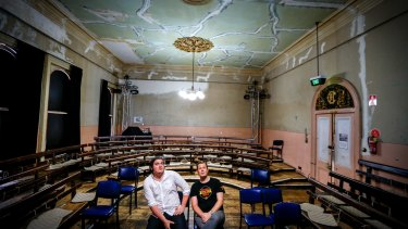 Trades Hall officials Luke  Hikakari and Matt Kunkel beneath a ceiling in need of repair.