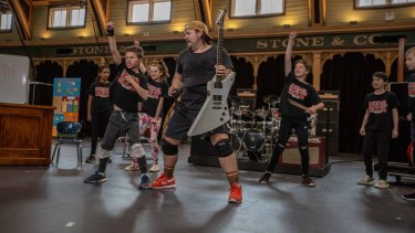 Brent Hill with younger cast members during rehearsals for School of Rock in Melbourne.