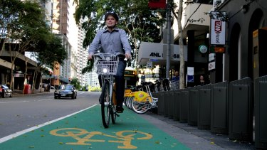 Public transport boss Adrian Schrinner says Brisbane' could benefit from voluntary helmet laws.