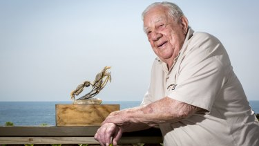 Noel Crocker with an early Nambucca Nippers trophy. The 94-year-old helped start the Nippers in 1961.