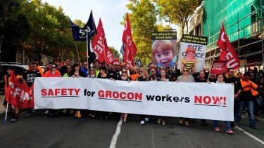 CFMEU and other union workers marched in support of worker's rights on Grocon sites. They held one minute's silence at the wall where three people died in Swanston Street.