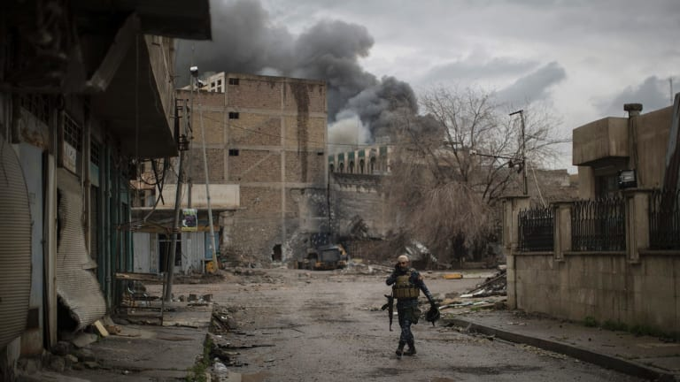 An Iraqi Federal Police officer walked the ruined streets of Mosul on Thursday.